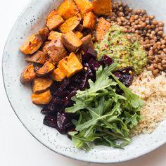 A guacamole, roasted chilli sweet potatoes, roasted beetroot, lentils, quinoa and rocket (arugula) salad - vegan, gluten free, vegetarian lunch