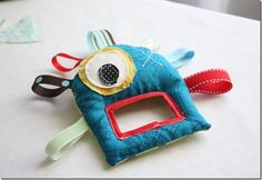 monster baby toy. what a cute gift idea.  #sewing #gift_ideas #for_baby #toys #fabric #diy #tutorial