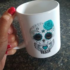 """I do not buy too many """"frivolous"""" things for myself but I treated myself to this adorable mug after all my hard work for a recent craft show. My coffee is tasting extra good this morning.  -michele . . . . . #coffee #coffeetime #coffeelover #java #coffeelove #coffeemug #mornings #sundaymorning #sugarskull #owl #sugarskullart #blue #turquoise #momlife #itsthelittlethings #relaxing #zookaboo"""