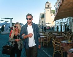Pin for Later: Jessica Simpson and Eric Johnson's PDA Is Out-of-Control Sexy  Eric and Jessica walked arm in arm during a vacation in Italy in October 2013.