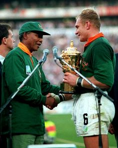 The iconic coming together of Nelson Mandela and Francois Pienaar as South Africa lift 1995 trophy