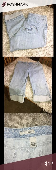 Chico's Platinum Denim Capris Size 12 Chico's Platinum Denim Capris.  Cuffed hemline style.  Light blue rinse color.  Chico's size 2, which converts to a 12.  Inseam is 21 inches long.   Great condition.  Important:   All items are freshly laundered as applicable prior to shipping (new items and shoes excluded).  Not all my items are from pet/smoke free homes.  Price is reduced to reflect this!   Thank you for looking! Chico's Jeans Ankle & Cropped