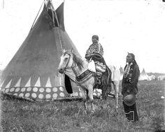 Black Weasel and wife. Blackfoot/Siksika. Montana. 1909. Photo by Walter McClintock.