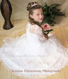 First communion gown made of satin with organza overlay Available exclusively through Christian Expressions.
