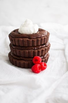 Chocolate Raspberry Tartlets - fudgy chocolate cake laced with raspberries baked into a chocolate cookie crust.