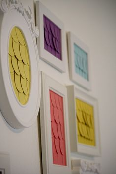 DIY Wall Art Idea: Use a circle punch on paint chips and frame them for a pop of color and texture.