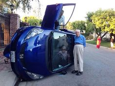 Making The Best Out Of A Bad Situation: Elderly Couple Pose For Photo After Their Car Flipped (Wife Still Trapped Inside)