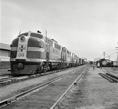 """Jack Delano, Office of War Information. March 1943. """"Flagstaff, Arizona. Diesel locomotive entering town along the Atchison, Topeka & Santa Fe Railroad between Winslow and Seligman."""""""