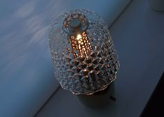 when the lamp is lit, the crystal shade casts its waffle reflection onto the base, and scatters light onto the surrounding surfaces.