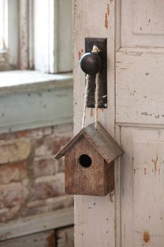 """This charming Folk Art Birdhouse is a cute addition to a bookshelf or to hang! We love the rustic farmhouse look! - 6""""x 4.5""""x 6.5"""" - Wood"""