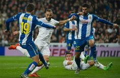 Espanyol's midfielder Joan Jordan Moreno and Espanyol's defender Alvaro Gonzalez vie with Real Madrid's French forward Karim Benzema during the Spanish league football match Real Madrid CF vs RCD Espanyol at the Santiago Bernabeu stadium in Madrid on January 31, 2016.