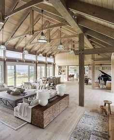 Open rafters create such a huge space..& I do like the creamy colors that the ceiling and rafters are painted.