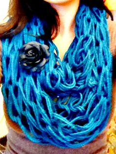 30 Minute Finger Knit infinity scarf, video at the bottom of the blog. I think this would look best in a dark color.