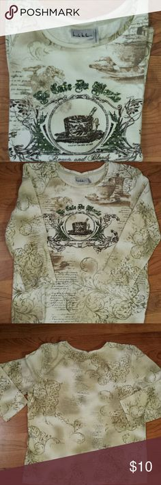 Nicole Miller T-Shirt EUC Adorable Cafe T-Shirt embellished with green jewels, goes just past the elbows, from shoulders down to hem is 23', Bust is 22 1/2'. Colors in Shirt are Brown, Tan, Green. Nicole Miller Tops Tees - Long Sleeve