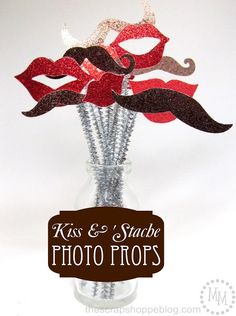 Kiss & 'Stache props for photos... actually cute with out being sad and dirty props