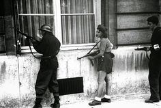 This is the young Simone Segouin , also known as Nicole Minet , his nom de guerre . In 1944 , at eighteen years old , she was pictured holding a MP -40 machine gun , helping to liberate Paris from the German rule . The picture became a symbol of women's participation in the Resistance .