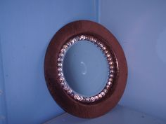 old copper tray and glass beads made into a mirror