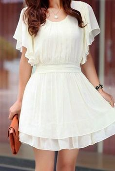 I'm not necessarily into white clothes but there's something about that dress that  makes me want one badly...