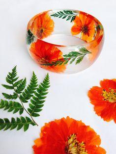 Real Orange Cosmos Flowers and Fern Bangle Bracelet Preserved in Eco Resin. Boho Summer Beautiful Botanical Jewelry by JupiterOak on Etsy https://www.etsy.com/listing/246097605/real-orange-cosmos-flowers-and-fern