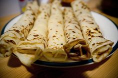 Palacsinta (crépes) | my mother made these to perfection! Made VERY thin for marmalade or jam spread, few drops lemon juice, rolled up with sprinkled powdered sugar on top! Yum