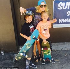 Mommy duty: On Friday, Britney Instagrammed a photo with her sons Sean, nine, and Jayden, eight, captioned, 'Just your typical proud skate mom'