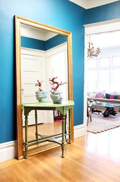 Benjamin Moore Slate Teal...I like the table in front of the mirror. Makes a small entry way seem so much bigger!