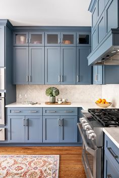 Soft blue cabinets with grey undertones make this kitchen from Beth Haley Design a stunner. Blue Gray Kitchen Cabinets, Kitchen Cabinet Colors, Kitchen Colors, Making Kitchen Cabinets, Blue Kitchen Ideas, Grey Kitchen Designs, Interior Design Kitchen, Home Decor Kitchen, Home Kitchens