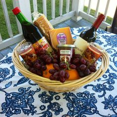 Wine basket. Two bottles of wine, candles, cheese and crackers, and fruit. Nice for any occasions!!
