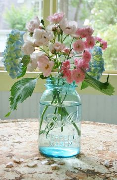Simple beautiful flowers in plain and simple jar. Always makes me smile