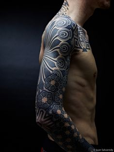 Abstract geometric arm sleeve tattoo Nazareno Tubaro