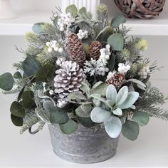 An elegant Christmas centerpiece. Can be used all winter long. Winter Floral Arrangements, Christmas Flower Arrangements, Christmas Greenery, Christmas Flowers, Elegant Christmas Centerpieces, Winter Centerpieces, Christmas Table Decorations, Christmas Tables, Farmhouse Fall Wreath