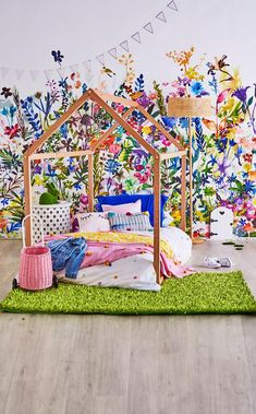This kids bedroom combines the whimsy of Alice in Wonderland and the beauty of a blooming garden to bring a sense of magic. Styling: Fiona Michelon
