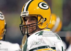Green Bay Packers quarterback Brett Favre on the sidelines during a game against the Minnesota Vikings on November 2006 in the Metrodome in Minneapolis, Minnesota. Green Bay beat Minnesota Get premium, high resolution news photos at Getty Images Nfl Football Players, Football Art, Football Helmets, Green Bay Packers Quarterbacks, Minnesota Vikings, News, Board, Planks