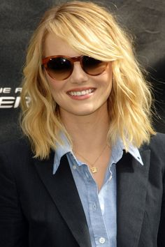 Hairstyles For Round Faces - Emma Stone With A Long Bob And Sweeping Fringe from InStyle.com