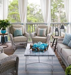 Coastal porch decor with striped rug, curtains and pillows in blue and sandy beige.... http://www.completely-coastal.com/2017/01/coastal-beach-house-blue-beige-in-watercolor-Florida.html