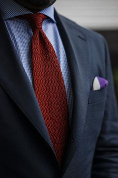Navy jacket, blue gingham shirt, red knit tie