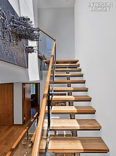 WOOD TREADS WITH POROSITY- STEEL CENTRAL STRINGER- Trooping the Colors: Revamp Enlivens Village Apartment | Projects | Interior Design