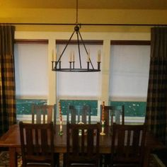 Motorized, pattern roller shades with drapery panels.  Customer in Eagle, Idaho - beautiful!  Budget Blinds of Boise