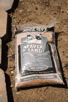 Once the trench was dug, we bought this paver sand.  This material is used to provide a solid base for retaining walls and patios.  If we had put the pavers directly on the dirt in the trench, it would eventually have settled and been uneven.  The paver sand locks the blocks in place and prevents settling.
