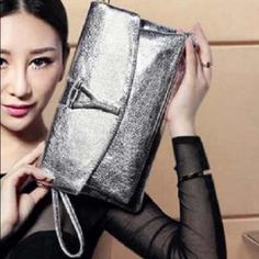 """Silver Clutch PU, exterior pocket, interior slot pocket, cell phone pocket, interior zipper pocket,interior compartment.                                                           There is no engrave on the """"Y"""" on the bag. Bags Clutches & Wristlets"""