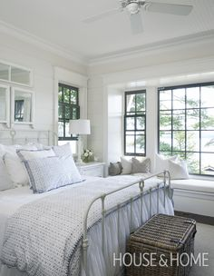 The classic white elements in this Muskoka bedroom are accented with natural fibers. | Photographer: Michael Graydon Designer: Muskoka Living Interiors