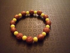 Acrylic amber heart and yellow glass bead bracelet by BritkneesBootique on Etsy