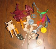 Loose Masters of the Universe parts and pieces in a grab-bag with action figures (MotU and G.I.Joes) for 1.99 at Goodwill
