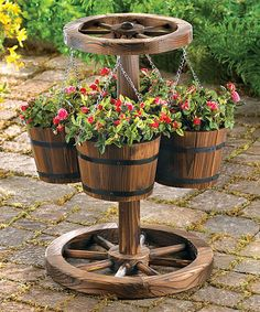 This Wooden Wheel Planter is perfect! #zulilyfinds