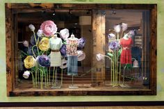 Greatness! Anthropologie pinning all their window designs, with flowers, from the cities where they have stores. #Northlake #Charlotte #Anthropologie