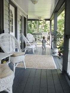A big front porch. With wicker furniture- eek! :D (also I notice the color of the house is the same as mine- maybe I should do my trim and front door like this...)