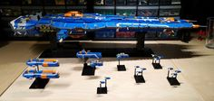 Building up some more support ships for my Hiigaran Fleet.  So far I have:  1x Battlecruiser 2x Pulsar Gunships 2x Ion Cannon Frigates 1x Flak Frigate 11x Interceptors (not very accurate to the game, but at this scale, I think its ok)  Wondering if I have enough blue pieces to build up something a little bigger to go with it, but I may just make another frigate.  We'll see.