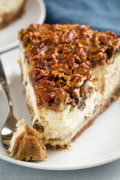 Pecan Pie Cheesecake Pecan Pie Cheesecake with real pecan pie filling on top of a creamy cheesecake base. If you love cheesecake and pecan pie you will want to make this recipe all season! The post Pecan Pie Cheesecake appeared first on Rezepte. Pecan Pie Cheesecake, Baked Cheesecake Recipe, Cheesecake Desserts, Just Desserts, Dessert Recipes, Autumn Cheesecake Recipes, Creamy Pecan Pie Recipe, Desserts With Pecans, Recipes With Pecans