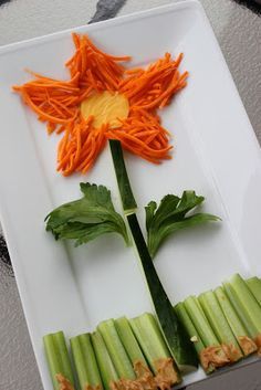 360 Family Nutrition: Food Art - Flower Style - includes: shredded carrots, American cheese, cucumbers, lettuce leaves, celery, and natural creamy peanut butter.