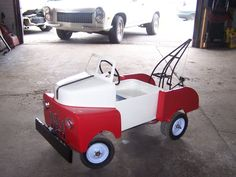 Hand fabricated pedal car tow truck at Lucky's Auto Body